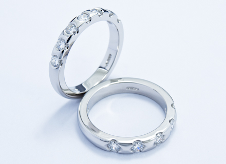 Eternity style platinum rings end set with round brilliant cut diamonds