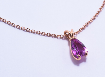 Bunny red gold pendant with sail shaped pink sapphire