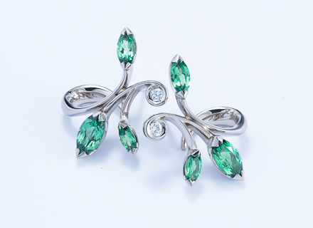 Floral white gold earrings with marquise cut tsavorite garnets