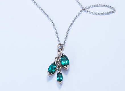 Floral white gold pendant with marquise cut tourmalines