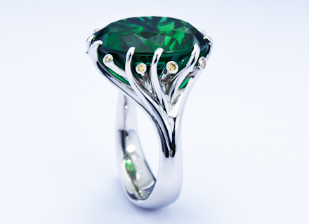 Meadow cluster platinum ring with emerald green tourmaline and diamonds