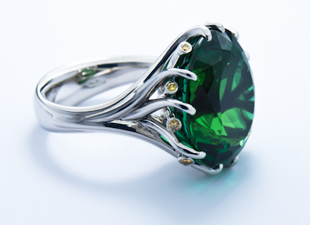 Meadow cluster platinum ring with emerald green tourmaline and it is set with an oval rare emerald green tourmaline weighing 1824ct and eleven natural canary yellow diamonds aloadofball Image collections