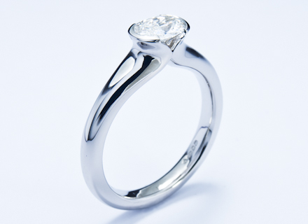 Kiss platinum ring with an oval brilliant cut diamond