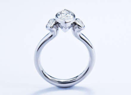 Rub Over Three Stone Platinum Ring With Marquise Cut