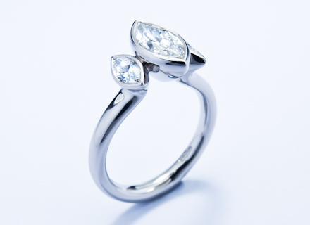 Rub over three stone platinum ring with marquise cut diamonds