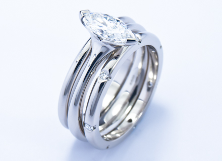 Four claw platinum ring with a marquise cut diamond