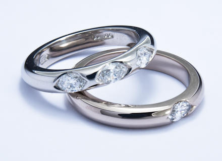Eternity style white gold and platinum rings end set with marquise cut diamonds
