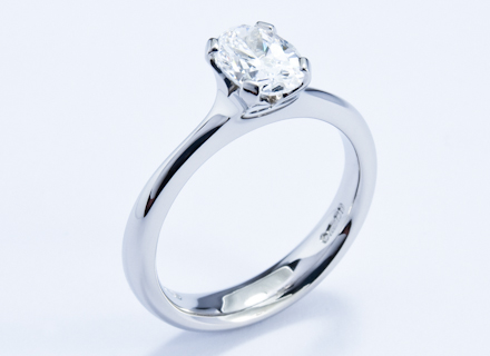Four claw platinum ring with an oval brilliant cut diamond