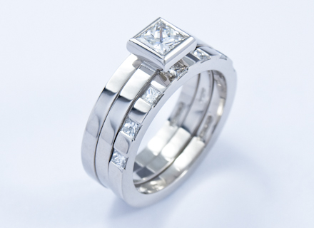 Eternity style platinum ring end set with princess cut diamonds