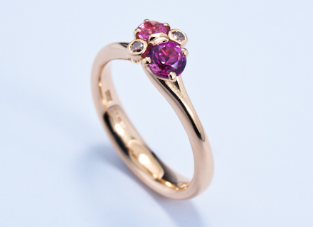 Meadow cross over cluster red gold ring with pink sapphires and diamonds