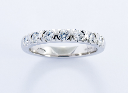Eternity style platinum ring end set with round brilliant cut diamonds