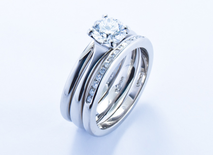 Four claw platinum ring with a round brilliant cut diamond