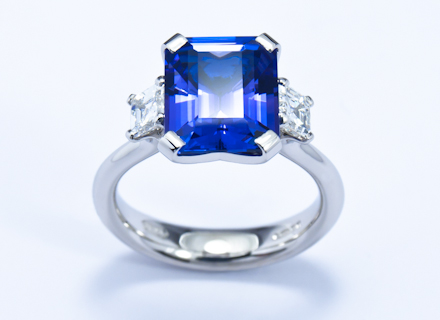 Four Claw Three Stone Platinum Ring With Emerald Cut