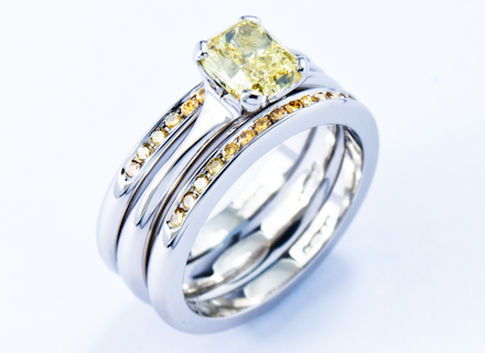Four claw platinum ring with a natural yellow diamond