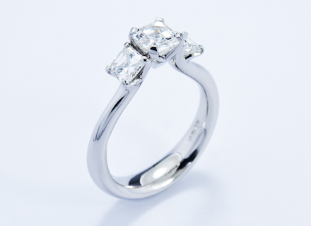 Four claw three stone platinum ring with asscher cut diamonds