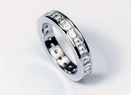 Eternity style platinum ring channel set with carre cut diamonds