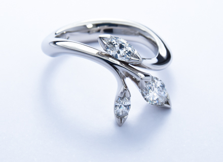 Floral platinum ring with marquise cut diamonds
