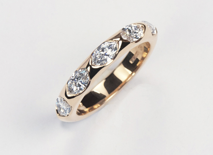 Eternity style rose gold ring end set with marquise cut diamonds