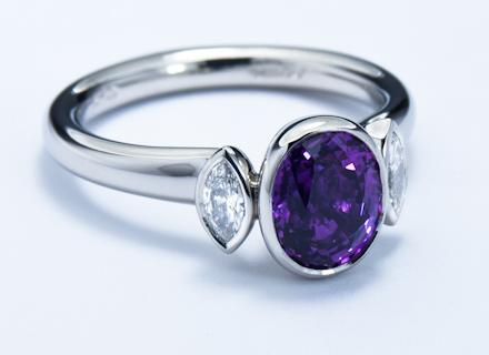 Rub Over Three Stone Platinum Ring With Purple Sapphire