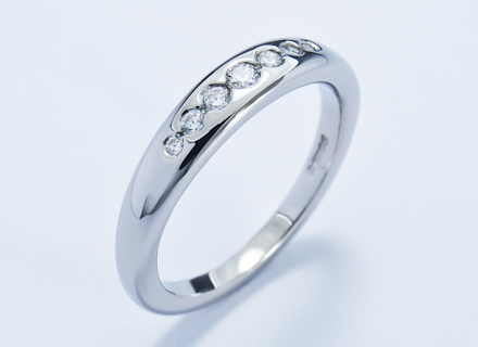 Eternity style ring channel set with graduated round brilliant cut diamonds